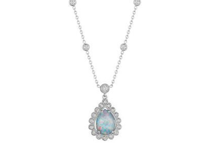 4- Penny Preville Scalloped pear shape opal triplet necklace is mounted with a white opal and diamonds.