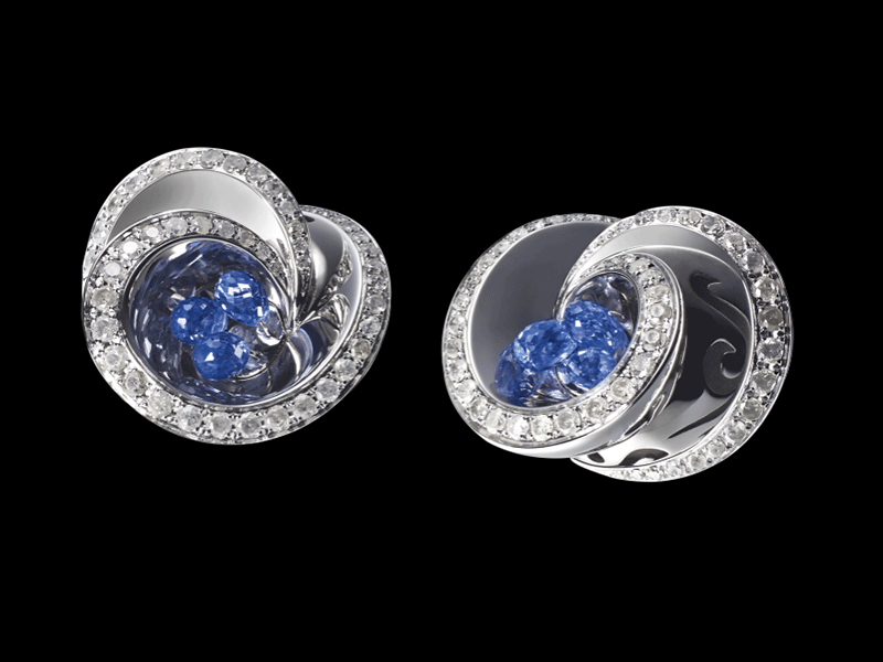 10- De Grisogono - Chiocciolina Earrings Mounted on white gold  and set with icy white diamonds, the earrings comprise  briolette-cut blue sapphires.