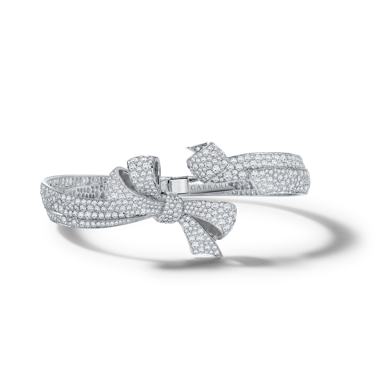 Garrard Bow bangle mounted on white gold with diamonds