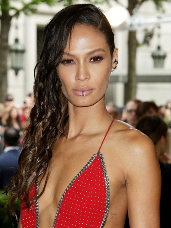 Anita Ko Joan Smalls wore diamond ear cuffs and lip rings.