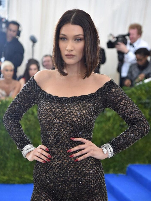 Bvlgari Bella Hadid wore Serpenti High Jewelry bracelets.