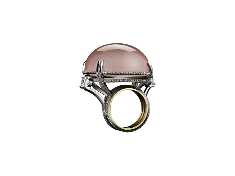Alexandra Mor Pink quartz cabochon orb ring is set slightly off-center while surrounded by pavé diamonds and two square-cut diamonds jutting out from the diamond band