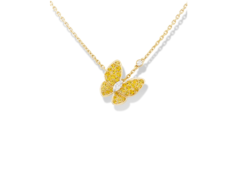 Van Cleef & Arpels Two butterfly pendant mounted on yellow gold round yellow sapphires