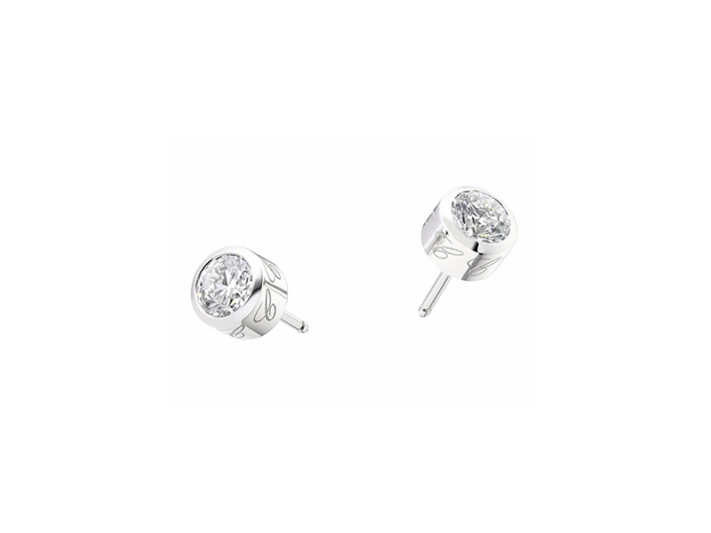 Chopard Dreams Earrings Mounted on white gold with white diamond.