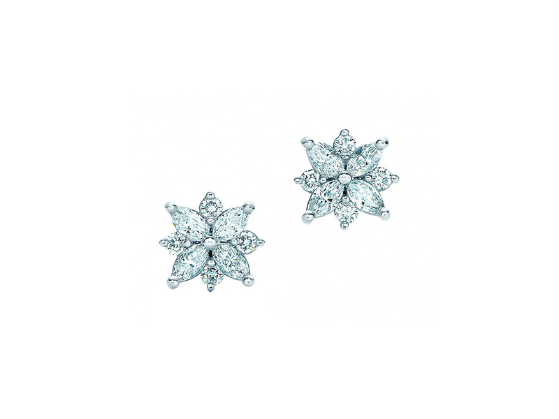 Tiffany & Co Cluster Earrings Mounted on platinum with marquise diamond (carat total weight .52) and round brilliant diamonds (carat total weight .20).