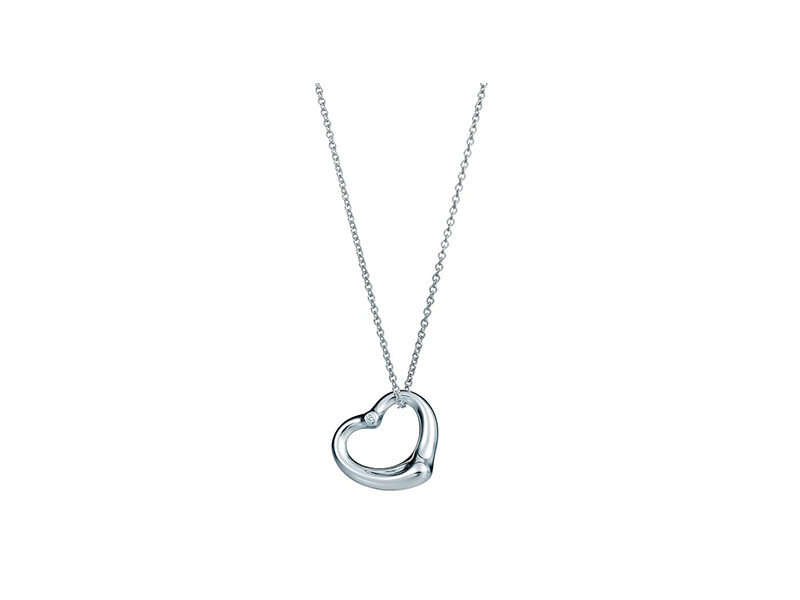 Elsa Peretti Open heart diamond necklace mounted on silver with a diamond