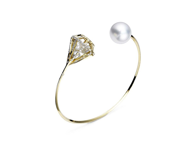 Melanie Georgacopoulos Couture diamond open bangle in yellow gold with a white south sea pearl white freshwater pearls and diamonds