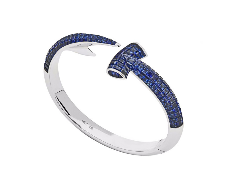 Stephen Webster Hammerhead hand crafted in 18 karat white gold and completed with square cut blue sapphires