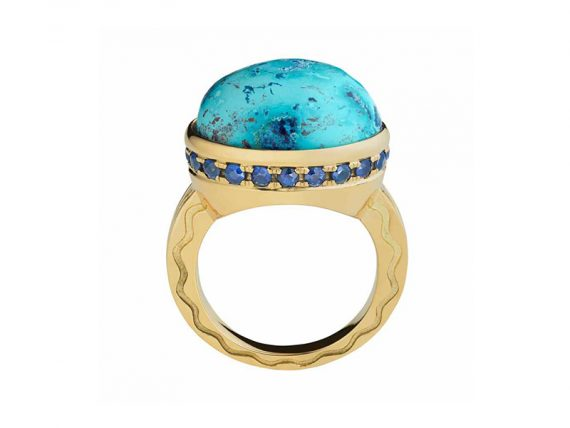 Misahara Talas ring set in etched 18k gold, is highlighted by a cabochon center stone surrounded by handset round brilliant sapphires and diamonds
