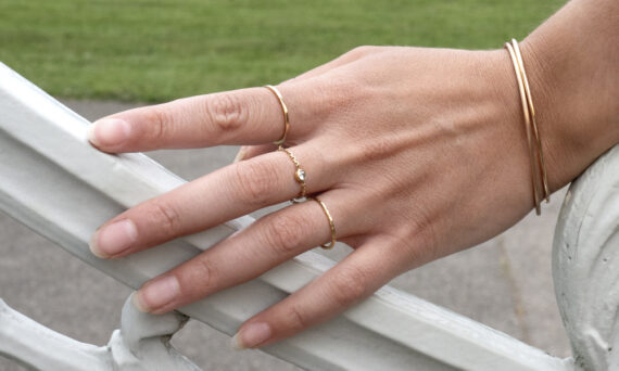 Rivka Nahamias 3 finger's ring 010 on gold with a diamond worn