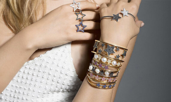 Women wearing rings and bracelets from the Stella collection by Spallanzani