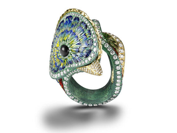 SICIS Quetzal Ring mounted on yellow gold and titanium set with diamonds and onice
