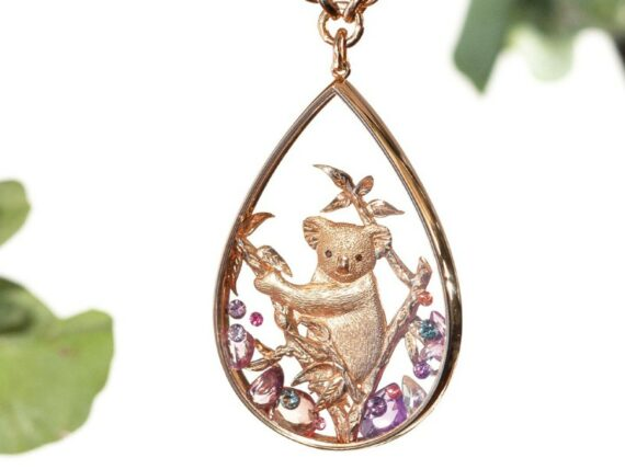 Alexandra Abramczyk Koala pendant mounted on rose gold with sapphires peach rose cut and multicolored round sapphires