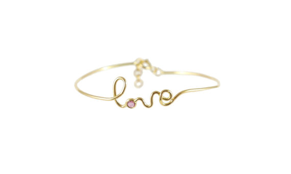 By Elia Love bracelet mounted on 18ct yellow gold with ruby