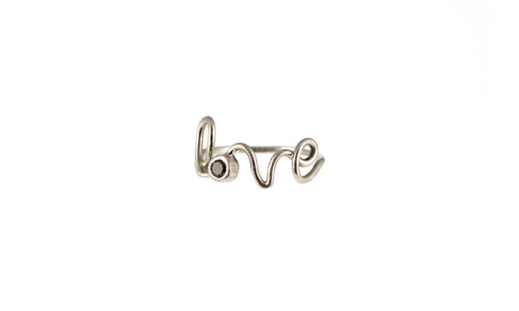 By Elia Love ring mounted on 18ct white gold with one black diamond