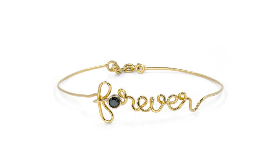 By Elia Forever bracelet mounted on 18ct yellow gold with one black diamond