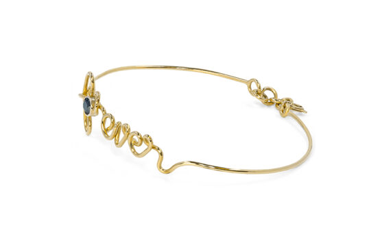By Elia Forever bracelet mounted on 18ct yellow gold with a black diamond