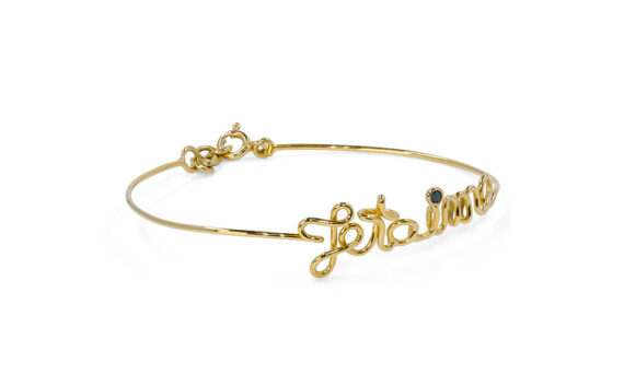 By Elia Je t'aime bracelet mounted on yellow gold with one black diamond