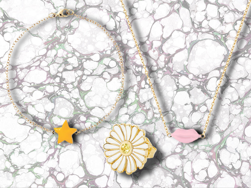 Alison Lou Enamel Daisy Stud 14K Yellow Gold ring, accented with white enamel petals and a single Yellow Sapphire center; Enamel Star Bracelet made of 14K Yellow Gold with a yellow enamel star, and Enamel Lip Necklace made with 14K Yellow Gold and pink Enamel Lips