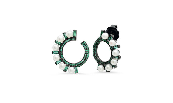 Colette Jewelry Swirl Huggie Hoops mounted on black gold with emeralds