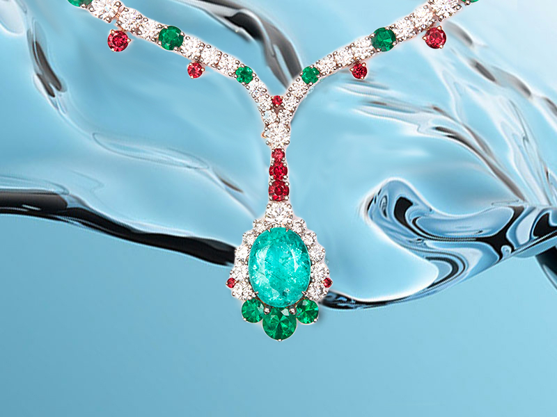 Pérouse Paris - Mozambique Paraiba necklace mounted on red gold and platinum, with emeralds, red spinels and diamonds