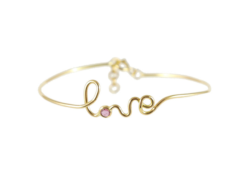 By Elia - Amour bracelet, mounted on yellow gold set with a pink ruby