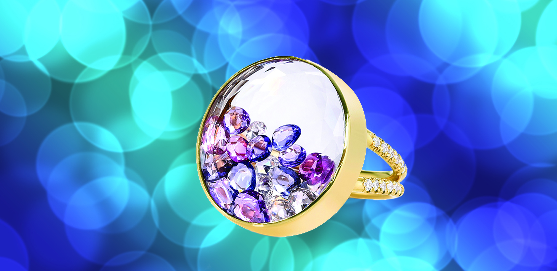 Moritz Glik - Ring mounted in yellow gold with rose cut color sapphires, rose cut diamonds and brillant cut diamonds set in and enclosed in a double white sapphire kaleidoscope shaker. Blue purple light