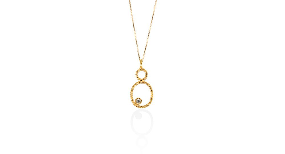 Tiny oval pendant with diamond