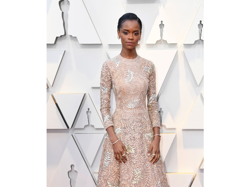 Cartier - Letitia Wright wore Cartier High Jewelry earrings mounted on platinum set with yellow sapphires and diamonds; Etincelle de Cartier bracelet on 18k rose gold and diamonds; Broderie and Etincelle de Cartier wedding bands