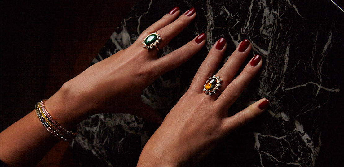 Nomad Jewels dark rings on marble
